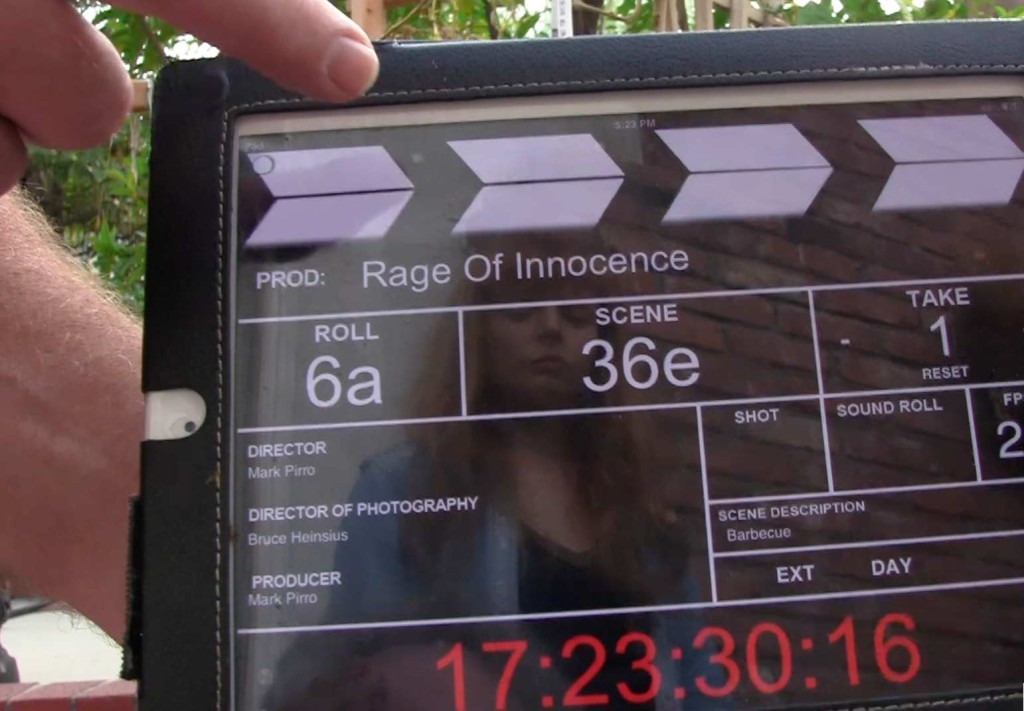 As we slate the shot for Rage of Innocence, actress Stef Dawson's reflection watches us