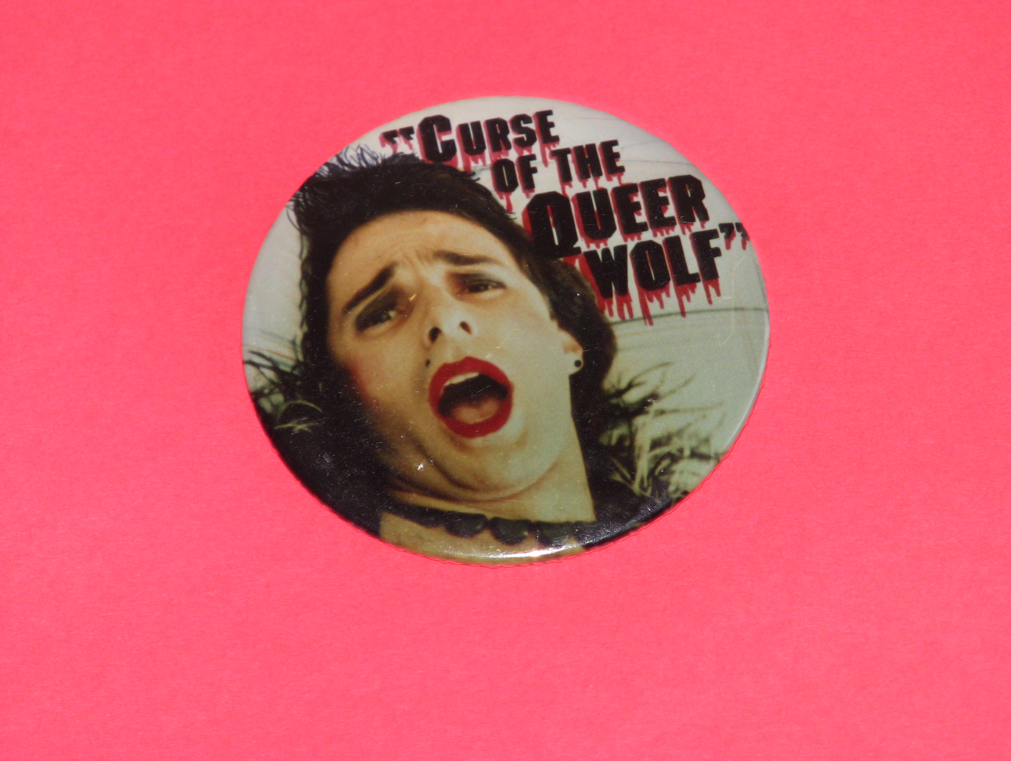 """Button created for the Premiere of Pirromount's 1988 Comedy, """"Curse of the Queerwolf."""""""
