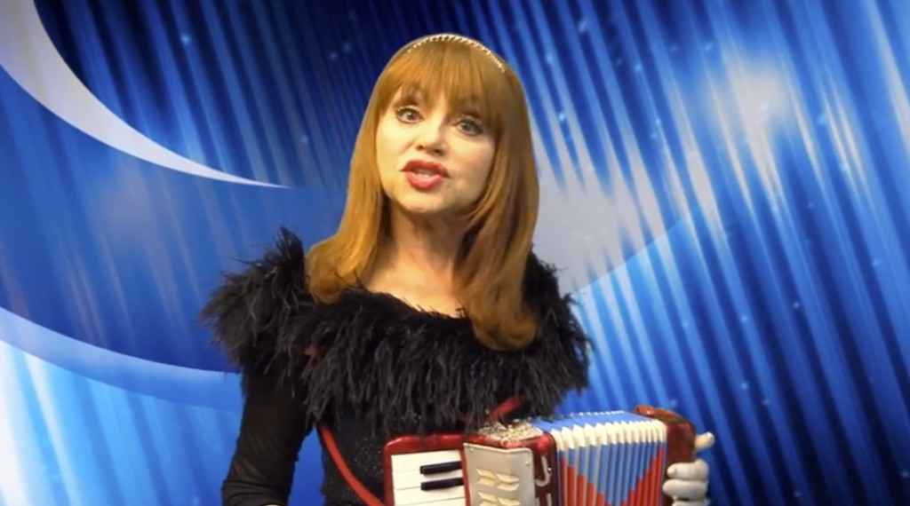 judy Tenuta playing accordion, blue and white background