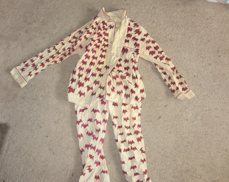 Bat pajamas, beige with red bats painted on.