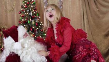 Judy Tenuta sitting on Santa's Lap